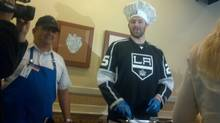 Los Angeles Kings' forward Dustin Penner serving up pancakes at a charity event Monday. (Eric Duhatschek)