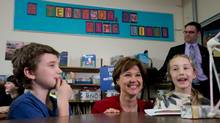 B.C. Premier Christy Clark, centre, appears with Lord Tennyson Elementary School Grade 5 student Lila Crawford, 10, in Vancouver in April 2013. (DARRYL DYCK for The Globe and Mail)