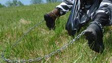 Prisoners pick up trash in Ohio (MIKE SIMONS/Mike Simons/AFP/Getty Images)