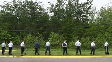 On June 9 2014, RCMP begin to search a wooded area behind a Moncton, New Brunswick shopping plaza located across a highway from the area where a suspected gunman was taken into custody. Justin Bourque, taken in a manhunt after allegedly shooting five RCMP officers, is charged with first degree murder in the deaths three RCMP officers. (Fred Lum/The Globe and Mail/The Globve and Mail)
