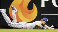 Toronto Blue Jays center fielder Colby Rasmus can't make a catch against the Milwaukee Brewers (Morry Gash/AP)