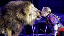 "Animal tamer Askold Zapashny of the Zapashny Brothers' circus kisses a lion during the premiere of the circus' show ""Camelot"" in St Petersburg (Alexander Demianchuk)"