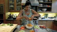 Siva Swaminathan, who teaches healthy nutrition classes to diabetics and is a diabetic herself, prepares gazpacho barley salad with peaches and corn at her home in Toronto. 'I want to demystify food and bring passion back to food for diabetics.' (Fernando Morales/The Globe and Mail)