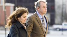Dennis Oland arrives at court in Saint John on Nov. 19, 2013, with his wife, Lisa. (MICHAEL HAWKINS/THE CANADIAN PRESS)
