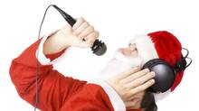 A cheesy stock photo of Santa Claus singing a song. (Getty Images/Ingram Publishing)