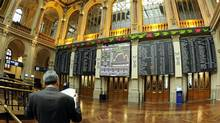A man reads documents at Madrid's stock exchange this week. (DOMINIQUE FAGET/AFP/Getty Images)