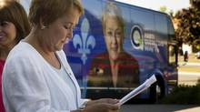 PQ Leader Pauline Marois reviews her briefing note prior to a news conference in Chateauguay, Que., on Saturday, September 1, 2012. (Paul Chiasson/THE CANADIAN PRESS)
