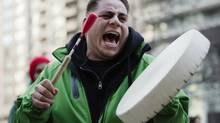 Protester Wayne Moberley sings traditional music as he takes part in the Toronto Idle No More demonstration. (MARK BLINCH/REUTERS)