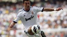 Real Madrid's Cristiano Ronaldo controls the ball during their Spanish first division soccer match against Valencia at Santiago Bernabeu in Madrid August 19, 2012. (SERGIO PEREZ/REUTERS)