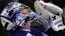 Toronto Maple Leafs goalie James Reimer gestures after defeating the Boston Bruins during their NHL hockey game in Toronto March 19, 2011. REUTERS/Mike Cassese (MIKE CASSESE)