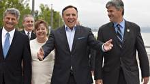 Coalition Avenir Quebec Leader Francois Legault, flanked by candidates, waves to awaiting supporters as he arrives at a news conference in Quebec City, Sunday, August 12, 2012. Quebecers are going to the polls on Sept. 4. (Jacques Boissinot/THE CANADIAN PRESS)