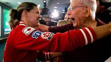 Canadian women's soccer team captain and Olympic bronze medalist Christine Sinclair, left, hugs her grandfather Reg Gant upon arrival from London at Vancouver International Airport in Richmond, B.C., on Monday, Aug. 13, 2012. (DARRYL DYCK/THE CANADIAN PRESS)