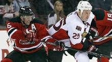 Ottawa Senators right wing Chris Neil (25) breaks between New Jersey Devils defenseman Andy Greene (6) and center Travis Zajac (19) in the third period of their NHL hockey game in Newark, New Jersey, April 12, 2013. (Reuters)