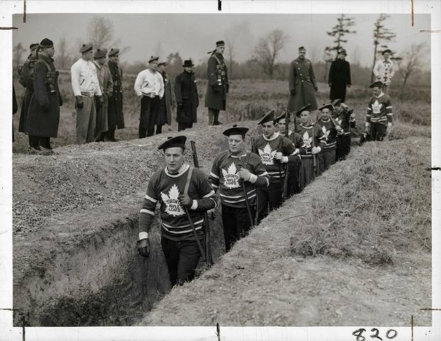 Unknown photographer for the Alexandra Studio. Distributed by the Star Newspaper Service and Times Wide World, [Members of the Toronto Maple Leaf hockey team in the trenches during a military training session], 1939, gelatin silver print.