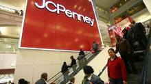 In this Friday, Oct. 23, 2009 photo, shoppers visit a J.C. Penney store in New York. (Mark Lennihan/AP)
