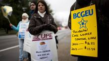Wednesday's 24-hour job action involved workers from 10 different unions that make up the Community Social Services Union Bargaining Association. Community living workers from various unions that include CUPE, BCGEU and HEU strike outside the Richmond Caring Place in Richmond, British Columbia, Wednesday, January 30, 2013. Rafal Gerszak for The Globe and Mail (Rafal Gerszak for the globe and mail)