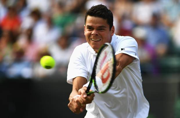 Milos Raonic of Canada hits a backhand during the Men's Singles Quarter Finals match against Sam Querrey of The United States on day nine of the Wimbledon Lawn Tennis Championships at the All England Lawn Tennis and Croquet Club on July 6, 2016 in London, England.
