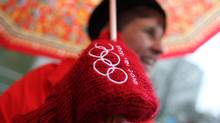Cathy Weston from Victoria wears her Olympic mittens. Photo: Peter Power/The Globe and Mail (Peter Power/Peter Power/The Globe and Mail)