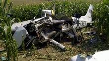 Debris from a plane crash sits in a field in Moorefield, Ont., on Sunday, Aug. 25, 2012. Police say a single engine Cessna crashed Friday night in a cornfield near Moorefield, about 50 kilometres northwest of Kitchener. (Transportation Safety Board/THE CANADIAN PRESS)