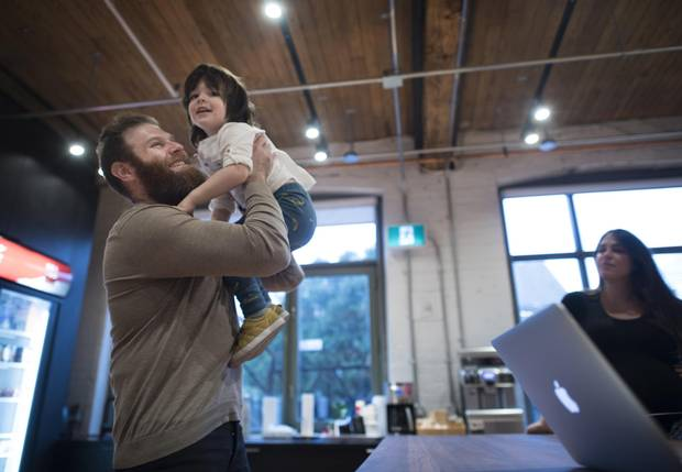 Jason Goldlist and his three-year-old son Abe are photographed in the offices of Wealthsimple on Nov. 14, 2017.