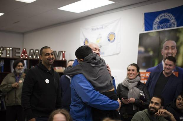 B.C. NDP leader John Horgan, left, is greeted by BC NDP candidate Ravi Kahlon's son Naven, 6, at his campaign office in Delta, British Columbia, Monday, April 10, 2017.