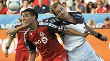 Toronto FC's Luis Silva tries to head a ball against Colorado Rapids' Tyson Wahl (R) during the first half of their MLS match in Toronto July 18, 2012. (MIKE CASSESE/REUTERS)