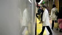 Commuters board a TTC subway car at Kennedy Station in Scarborough on Sept. 25, 2013. (KEVIN VAN PAASSEN/THE GLOBE AND MAIL)