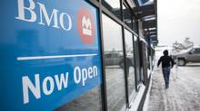 A man enters a new Bank of Montreal (BMO) branch, located in Fort McMurray, Alberta, Tuesday, February 05, 2013. (Brett Gundlock For The Globe and Mail)