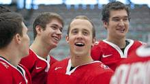 Jaden Schwartz shares a laugh with his teammates at the official announcement of C anada's national junior team in Calgary on Wednesday. (Chris Bolin for The Globe and Mail)