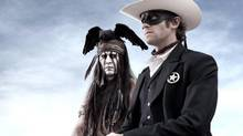 "This undated publicity photo from Disney/Bruckheimer Films, shows actors, Johnny Depp, left, as Tonto, a spirit warrior on a personal quest, who joins forces in a fight for justice with Armie Hammer, as John Reid, a lawman who has become a masked avenger, The Lone Ranger, from the movie, ""The Lone Ranger."" The film opens nationwide on July 3, 2013. (Peter Mountain/THE CANADIAN PRESS)"