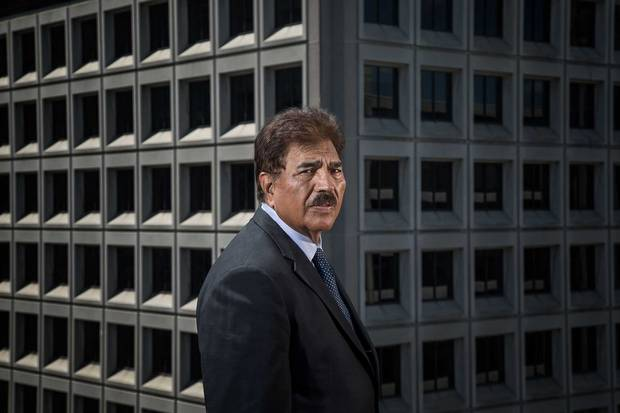 Morguard Corp CEO Rai Sahi photographed in front of 77 Bloor St W in Toronto, a workhorse of a building typical of the kind in his company's portfolio