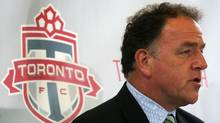 "Tom Anselmi COO of Maple Leaf Sports and Entertainment answers a reporters question about Toronto FC soccer coach Maurice ""Mo"" Johnston at Scallywags bar on St. Clair W. on August 25, 2006.   (Jim Ross/The Globe and Mail)"