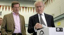 Former Ontario Progressive Conservative party leader John Tory, left, watched his father John Tory Sr. cast his ballot in the 2007 Ontario provincial election (MIKE CASSESE/REUTERS)