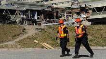 Police and investigators head towards the Algo Centre Mall on June 29, 2012 in Elliot Lake, Ont. (Fred Lum/The Globe and Mail)
