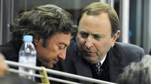 Edmonton Oilers owner Daryl Katz, left, speaks with NHL commissioner Gary Bettman during a game between the Oilers and the Atlanta Thrashers in February, 2011. (JOHN ULAN/THE CANADIAN PRESS)