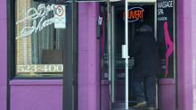 A man enters a massage parlour in Montreal on Friday, December 13, 2013.