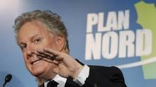 Quebec's Premier Jean Charest speaks during a news conference after the presentation of the Plan Nord at the congress center in Levis May 9, 2011. (MATHIEU BELANGER/REUTERS)