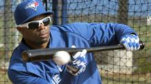 Toronto Blue Jays' outfielder Rajai Davis bunts during practice at their MLB American League spring training facility in Dunedin, Florida Feb. 27, 2012. (Mike Cassese/Reuters/Mike Cassese/Reuters)