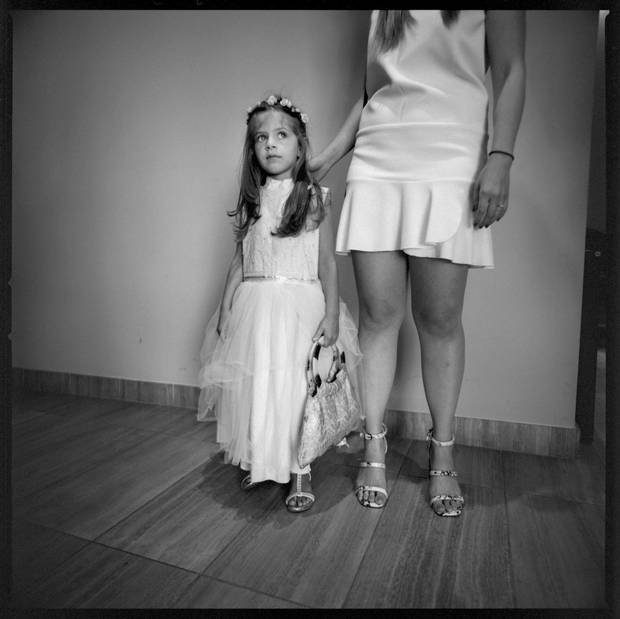 Frances McAllister, 5, was the flower girl for her sister Ariana's ceremony.
