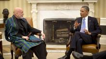 U.S. President Barack Obama meets with Afghanistan's President Hamid Karzai in the Oval Office of the White House in Washington, January 11, 2013. (JASON REED/Reuters)