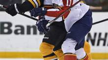 When linemates are taken into account, the Florida Panthers' Jonathan Huberdeau should have a leg up with the voters from the Professional Hockey Writers' Association. Here he collides with Boston Bruins defenceman Andrew Ference this month. (Charles Krupa/The Associated Press)