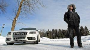Gold medalist Alexandre Bilodeau with his car, a 2011 Audi S4, in Montreal.