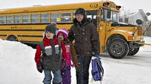 Marjorie Kirsop walks with her kids Paul 7, (left) and Sarah 5, Kirsop after the school bus from Notre Dame Elementary School dropped them off near her home in Morinville on Wednesday March 2, 2011. (Jason Franson for The Globe and Mail/Jason Franson for The Globe and Mail)