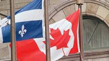 The Quebec and Canadian flags. (Jacques Boissinot/The Canadian Press)