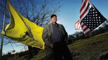 Michael Bishop poses Dec. 11, 2012, near the entrance to his property south of Douglass, Tex., which is directly in the path of the Keystone pipeline project. (Andrew D. Brosig/AP)