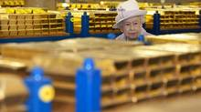 Britain's Queen Elizabeth tours a gold vault during a visit to the Bank of England in the City of London. (Eddie Mulholland/Pool/REUTERS)