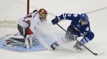 Toronto Maple Leafs' Mason Raymond scores on Ottawa Senators' Craig Anderson, left, in the shootout during NHL action in Toronto on October 5, 2013. (Peter Power/The Globe and Mail)