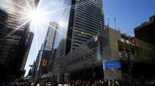 People pass by Bank of Montreal headquarters in Toronto on Tuesday, Aug. 28, 2012. BMO has the second-lowest market cap of the Big Five after CIBC. (Michelle Siu/The Canadian Press)