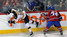 Boston Bruins right wing Nathan Horton (18) falls after battling for the puck against Montreal Canadiens defenseman Alexei Emelin (74) and captain Brian Gionta (21) during the first period at the Bell Centre. (Jean-Yves Ahern-US PRESSWIRE/US PRESSWIRE)