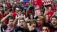 Thousands of striking students march down the streets of Montreal as they demonstrate against tuition hikes Thursday, March 22, 2012. (Paul Chiasson/THE CANADIAN PRESS)